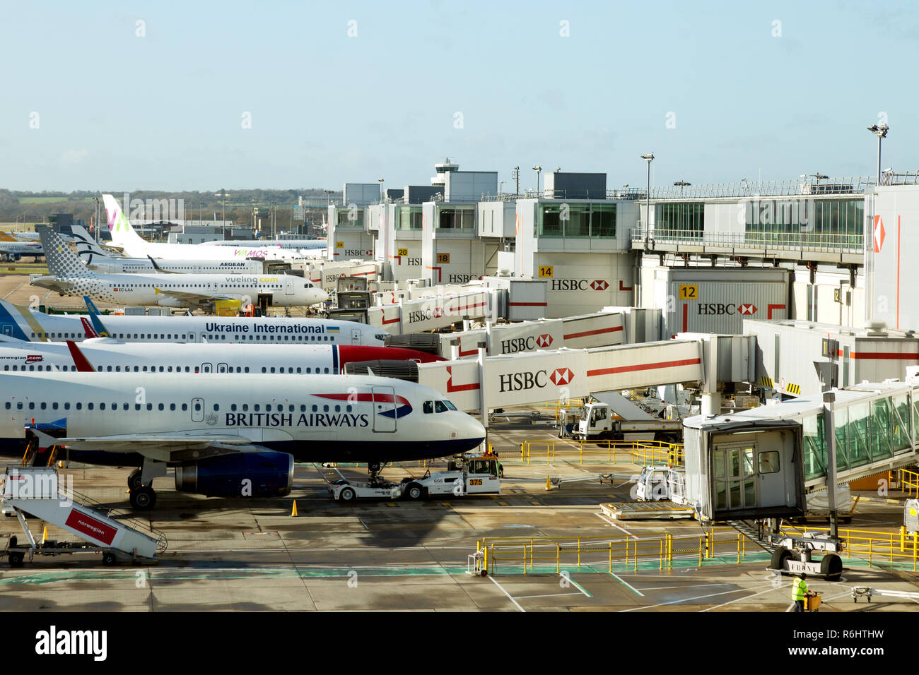 Planes, Gatwick Airport - airplanes at South terminal, Gatwick airport, UK - Stock Image