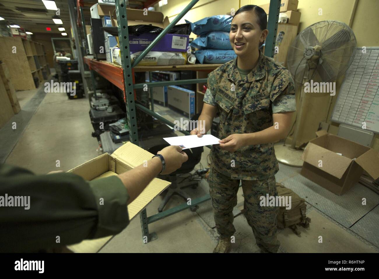 Sergeant Kyle J. Gorman, a satellite communications technician assigned to Special Purpose Marine Air-Ground Task Force-Crisis Response-Africa, delivers a hand-written letter to Cpl. Ivett Romerobenitez, an assistant wire chief with SPMAGTF-CR-AF, at Morón Air Base, Spain, May 19, 2017. The letters were written by third grade students from Freedom Elementary School in Brandenton, Fla. - Stock Image