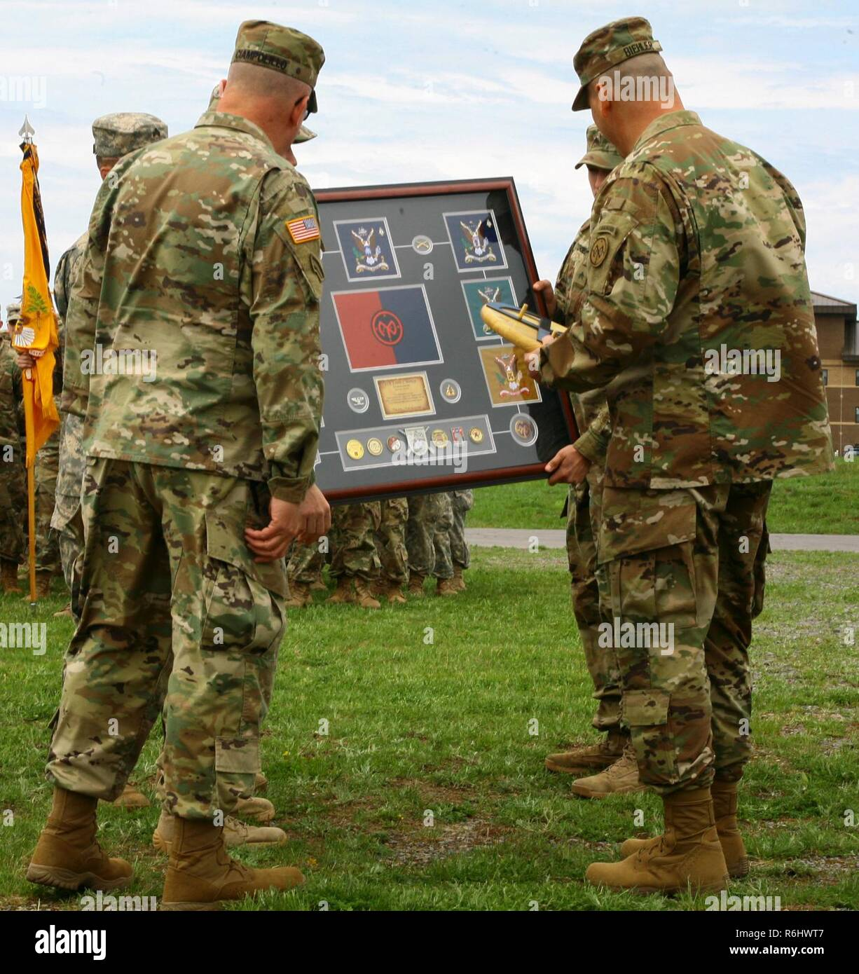 New York Army National Guard Col. Joseph Biehler, the outgoing 27th Infantry Brigade Combat Team commander is presented with a plaque commemorating his tenure as the unit's commander during a change-of-command ceremony at Fort Drum, N.Y.,  May 21. Following the ceremony Biehler was promoted to the rank of brigadier general. Stock Photo