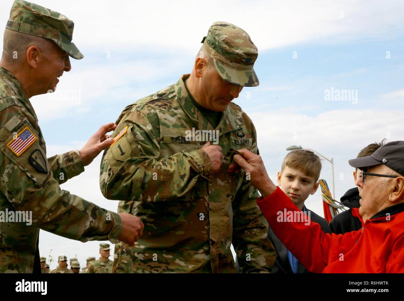 New York Army National Guard Brig. Gen. Joseph Biehler, the outgoing 27th Infantry Brigade Combat Team commander receives his new rank insignia from his father, John Biehler while being promoted to the rank of brigadier general during a change-of-command ceremony at Fort Drum, N.Y. , May 21 2017. Following his tenure with the 27th IBCT, Biehler will serve as the 42nd Infantry Division's executive officer. Stock Photo