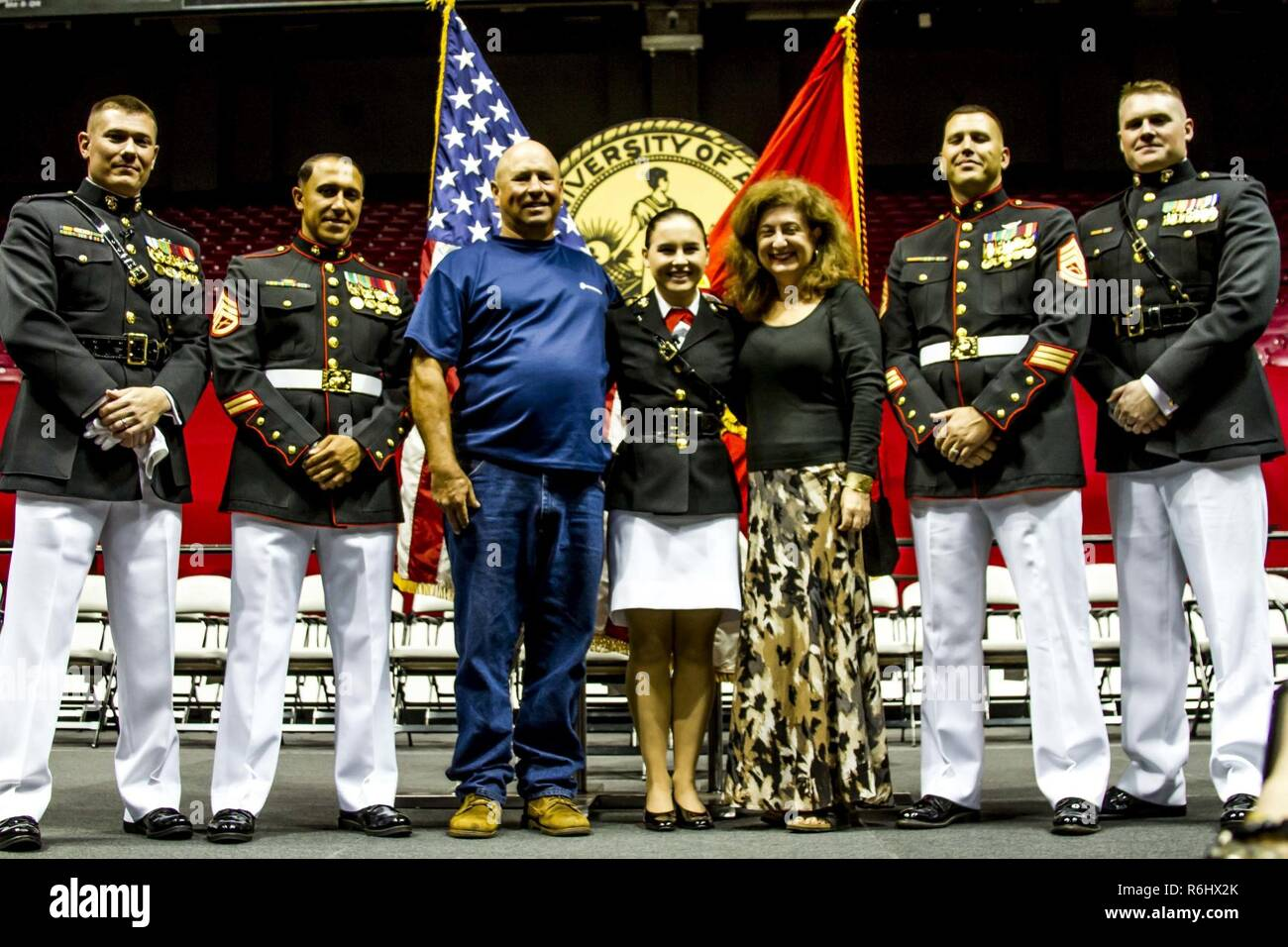 "Second Lieutenant Mary Sanders poses with Marines with the officer selection team for Recruiting Station Montgomery and family members after her commissioning ceremony at Coleman Coliseum, May 12, 2017. Sanders is a recent graduate of Alabama State University and attended Platoon Leaders Course and Officer Candidate School before being commissioned. ""After a couple of weeks I saw how the Marine Corps worked and was hooked. I was so inspired and motivated that if I had any doubts before, they were gone. This was something I wanted to be a part of."" - Stock Image"