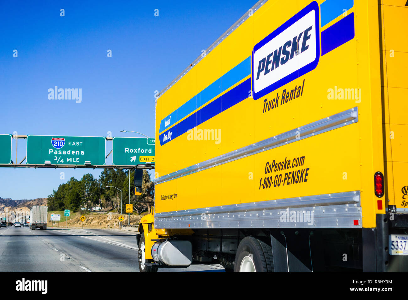 December 3, 2018 Los Angeles / CA / USA - Penske rented truck driving on the freeway - Stock Image