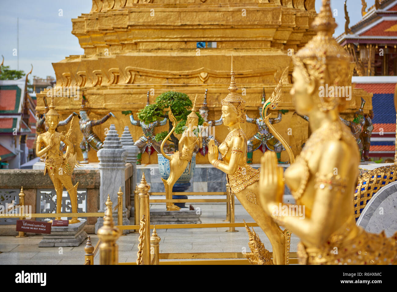 Golden dancer statues inside the Grand Palace in Bangkok, Thailand. Stock Photo
