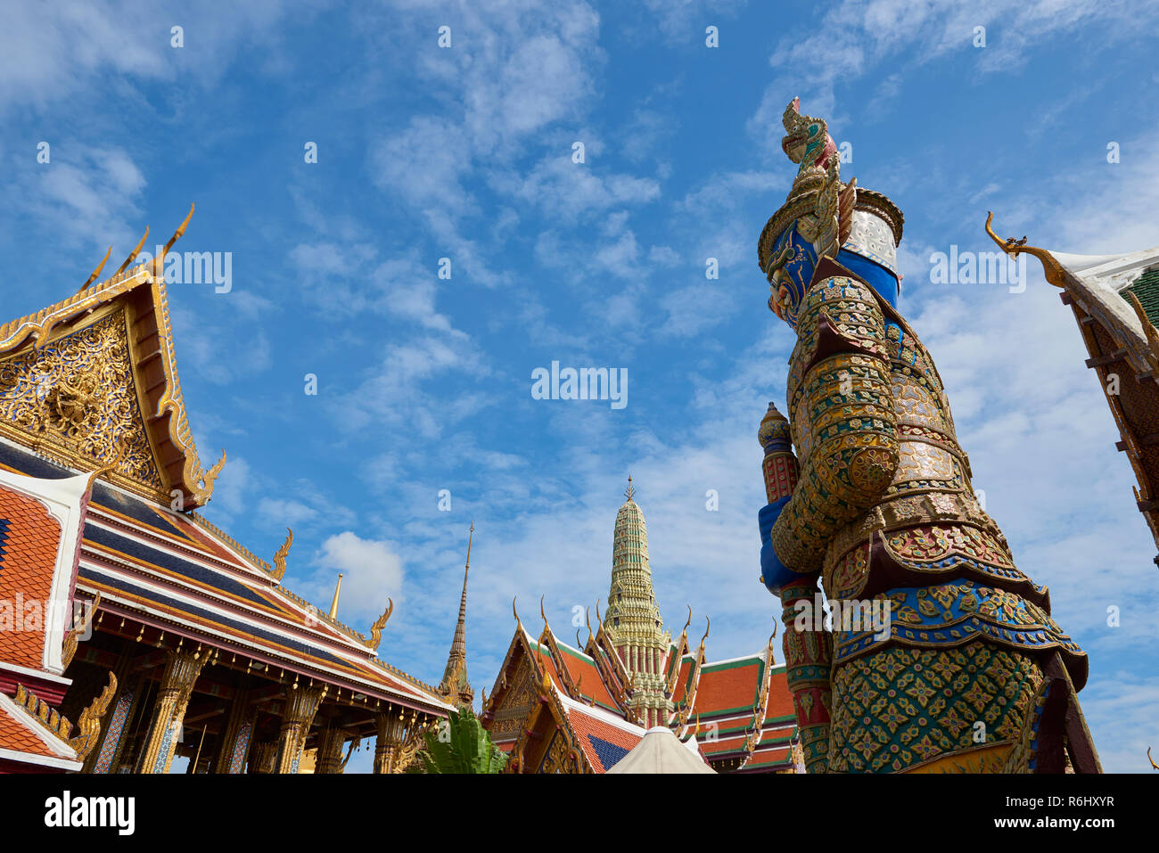 Yaksha statue in the Grand Palace facing a temple entrance in Bangkok, Thailand. The demon-gods statues are a common sight in Buddhist temples in Thai Stock Photo