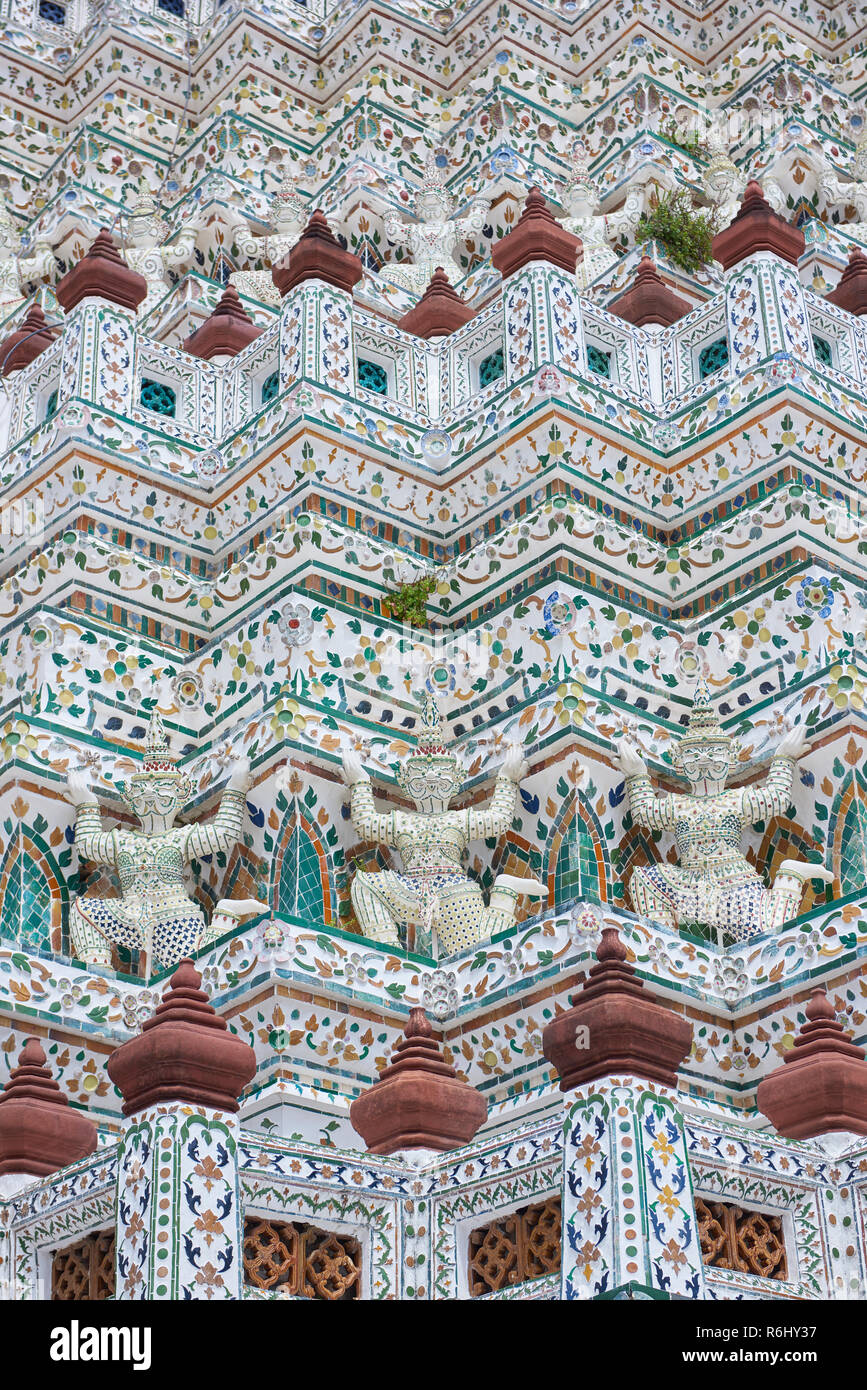 White Yaksha and dancer statues in Wat Arun temple in Bangkok, Thailand. The demon-gods statues are a common sight in Buddhist temples in Thailand, bu Stock Photo