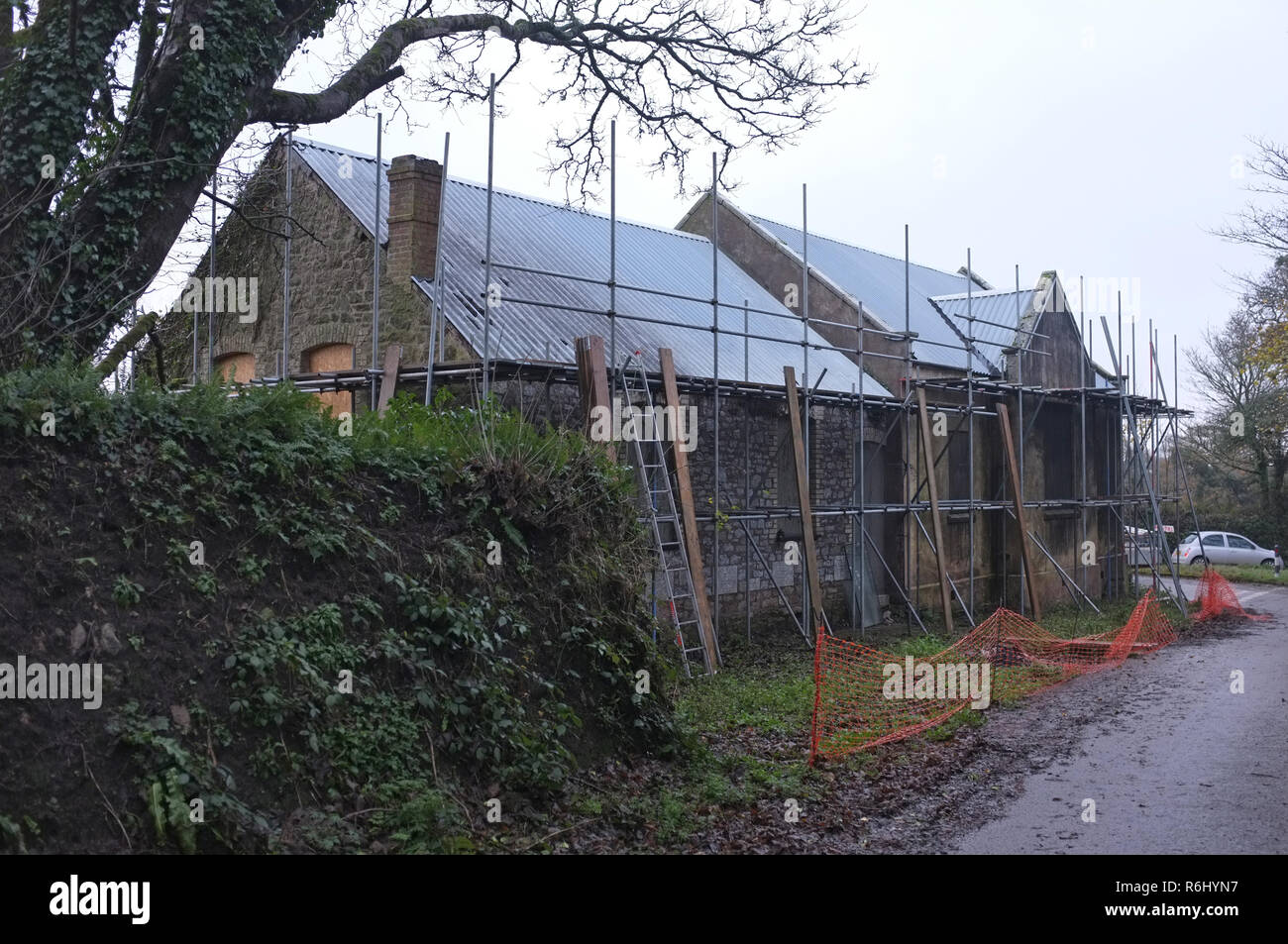Scaffolding on an old Methodist chapel church being converted into a house. Rural development. Cornwall. - Stock Image