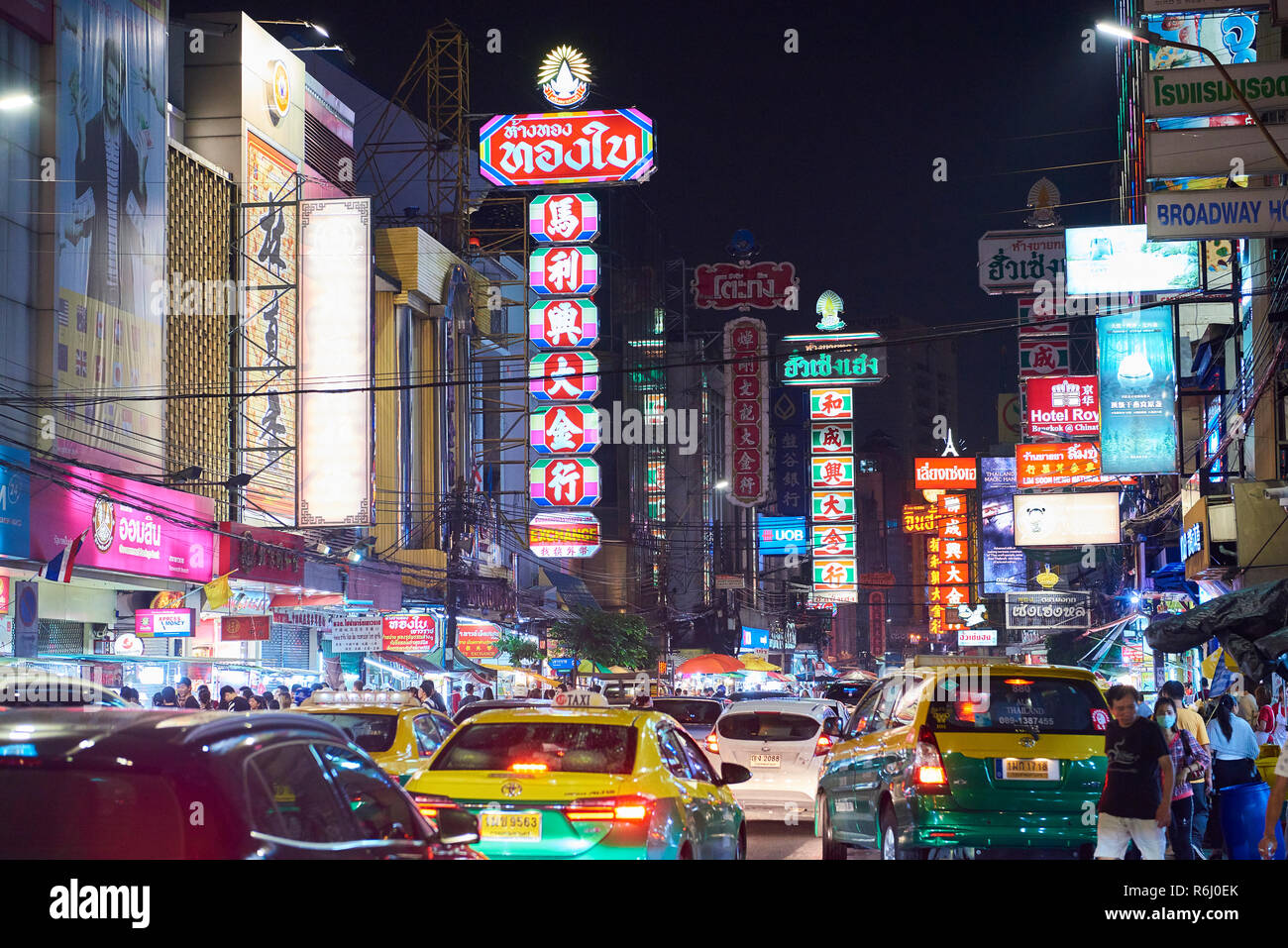 Night shot of Chinatown district in Bangkok, Thailand, with heavy traffic and neon signs. Stock Photo