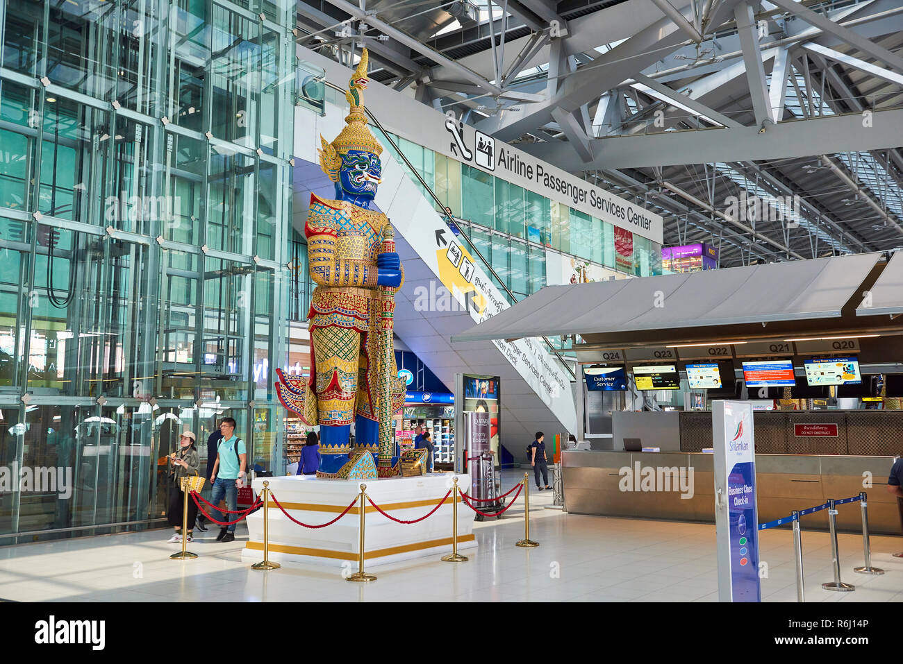 Large Yaksha statue in Suvarnabhumi Airport lobby in Bangkok, Thailand. Stock Photo