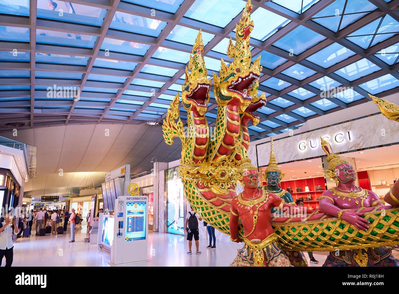 Statues representing the Hindu Churning of the Milk story in Suvarnabhumi Airport lobby in Bangkok, Thailand. Stock Photo