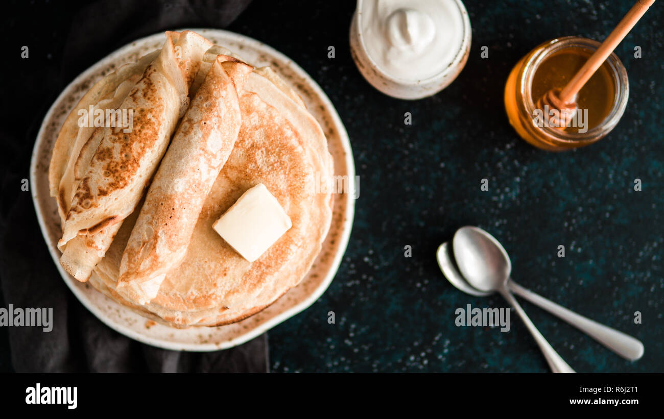 russian pancakes blini on black with copy space - Stock Image