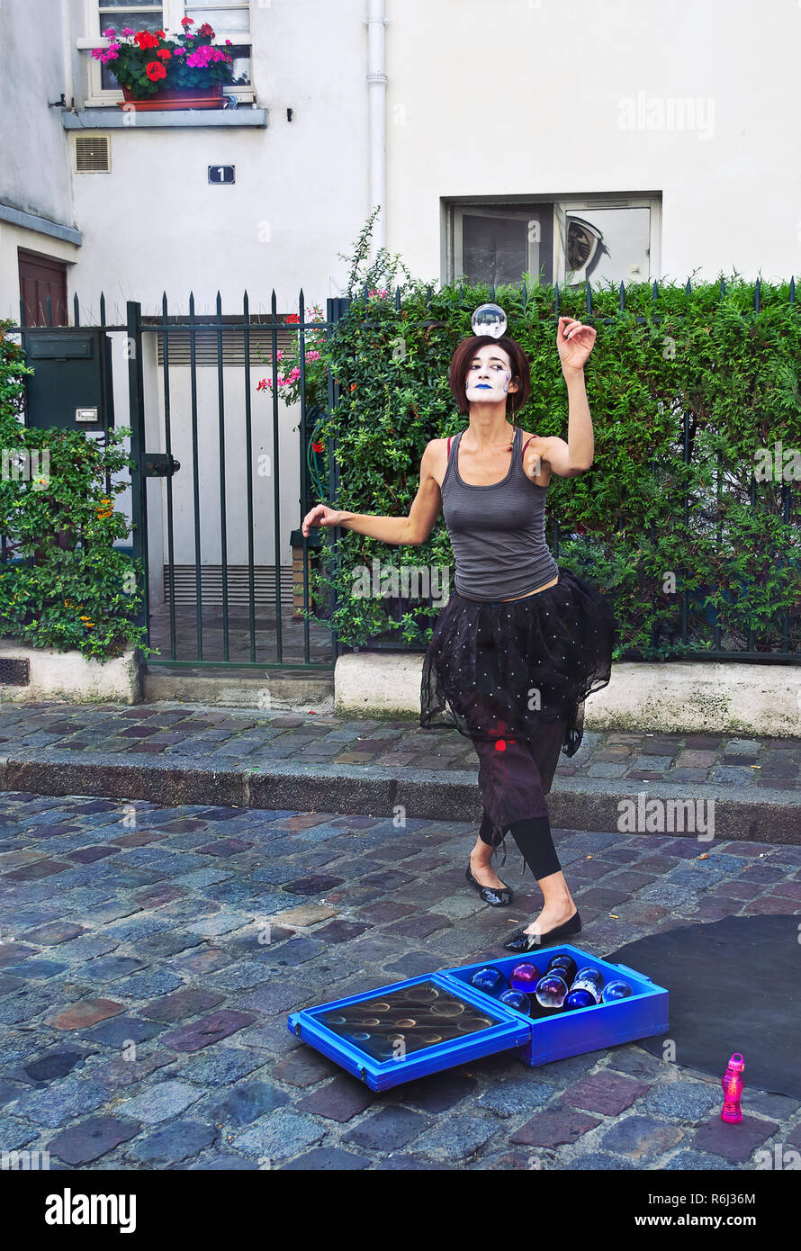 PARIS - September 08: Mime dancing with a magic ball on the head in Montmartre, Paris, France. on September 08 2013. Montmartre area is among most pop - Stock Image