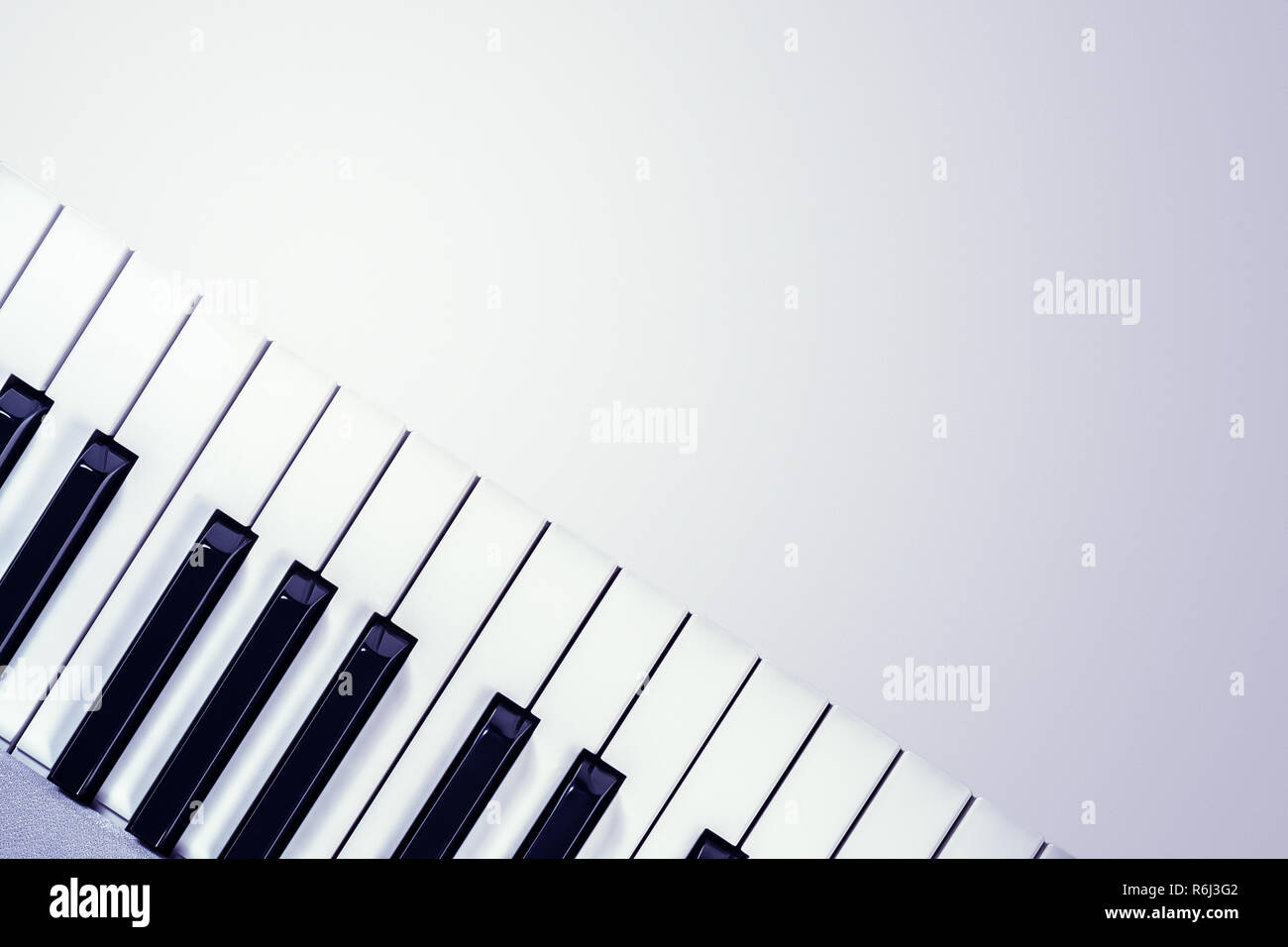 View from above of a synthesizer keyboard  isolated on a gradient gray background - Stock Image