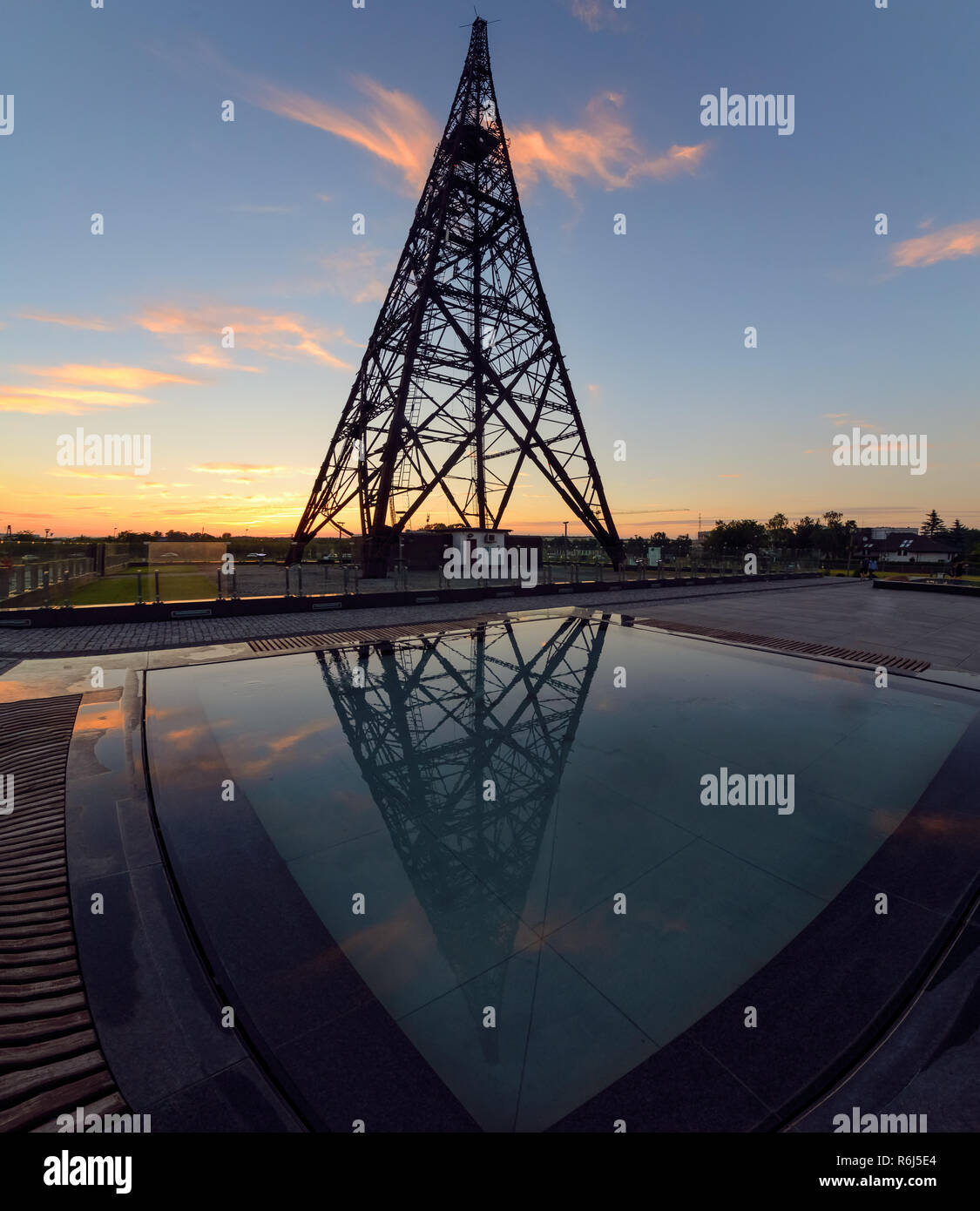 Historic radiostation tower in Gliwice and reflaction, Poland in sunset time. - Stock Image