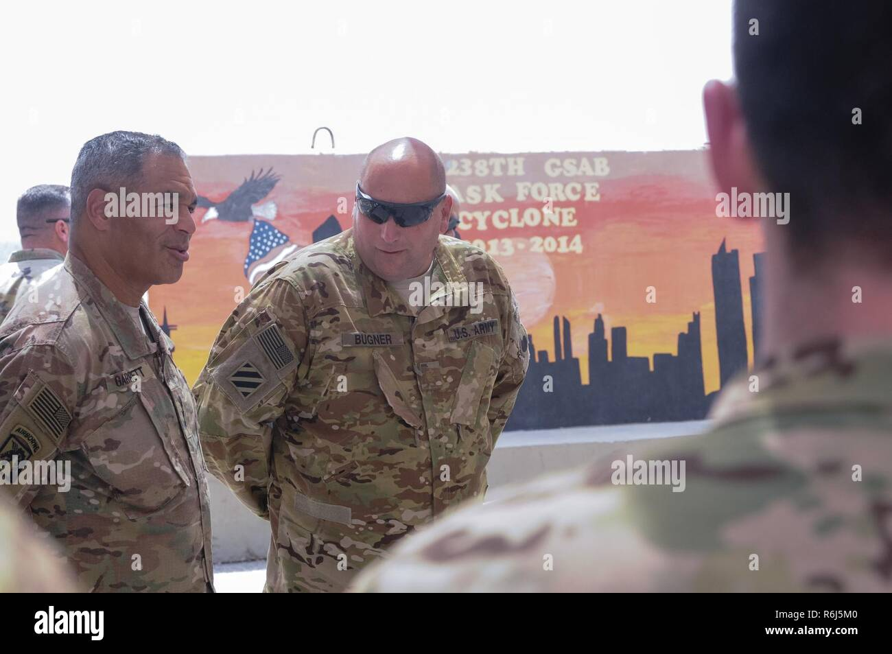 The Commanding General of U.S. Army Central Lt. Gen. Michael X. Garrett, discusses the achievements and capabilities of the 2nd General Support Aviation Battalion, 149th Aviation Regiment with Maj. Robert Bugner on May 19 at Camp Buehring, Kuwait. - Stock Image