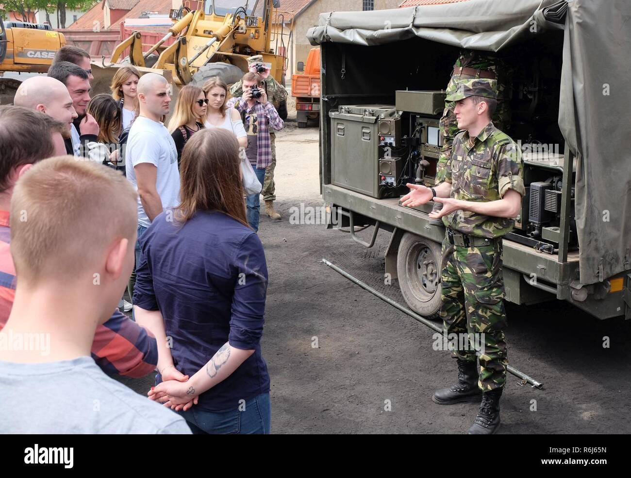 04afa9d68f3 Battle Group Poland Romanian soldier 1st Lt. Anghel Valer Huiu teaches the  cadets of War
