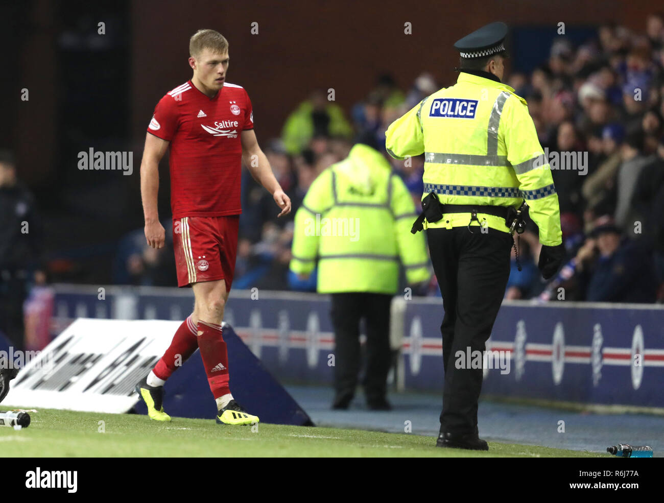 Aberdeen's Sam Cosgrove is sent off during the Ladbrokes Scottish Premiership match at Ibrox Stadium, Glasgow. - Stock Image