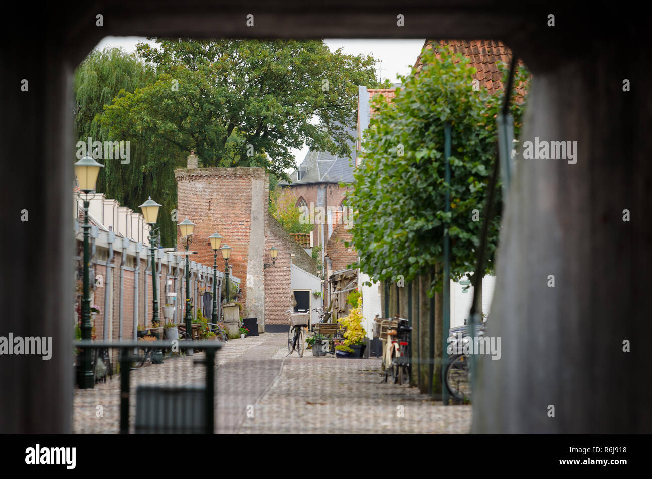 Narrow street in the old town of Elburg. An old tourist fortress in the Netherlands that goes back to the Middle Ages and was part of the sites around - Stock Image