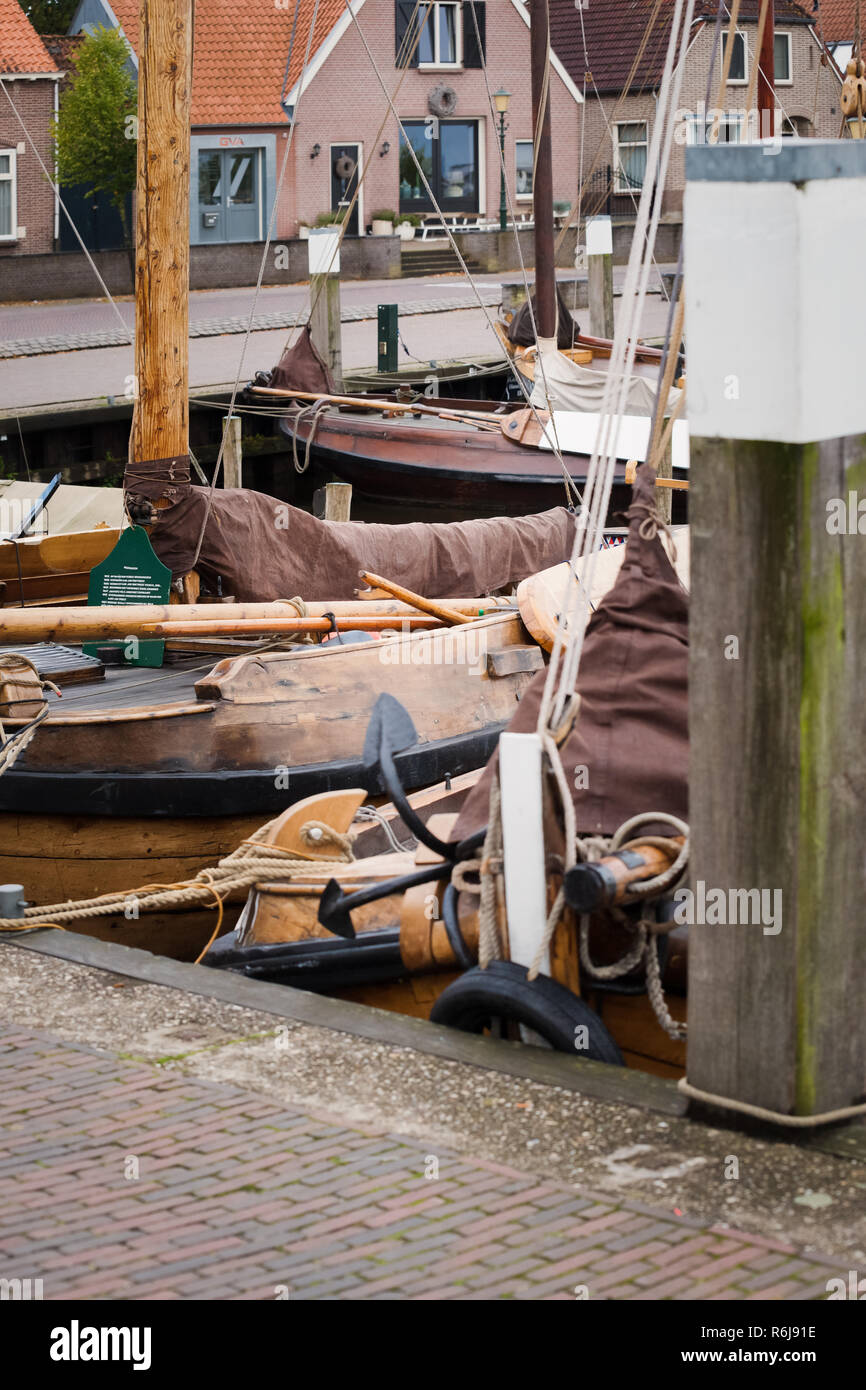 Historical ships and fishing vessels anchored in the harbor of the old town Elburg in the Netherlands. Historic sailboats of the Dutch inland Zuiderze - Stock Image