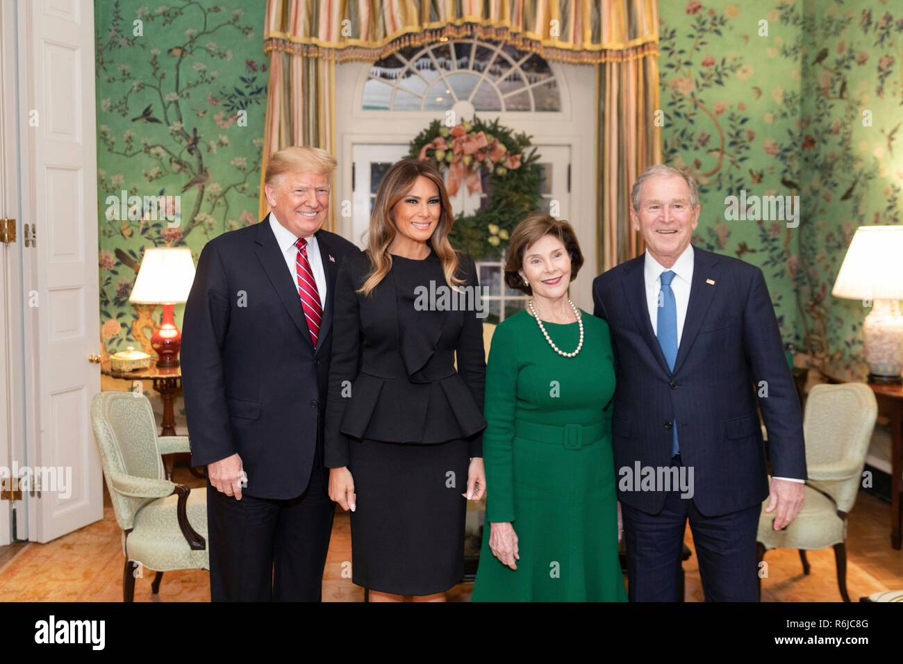 Washington DC, USA. 4th December, 2018. Former U.S. President George W. Bush, right, and Laura Bush stand together with President Donald Trump and First Lady Melania Trump inside Blair House December 4, 2018 in Washington, DC. Bush is staying at Blair House to attend the memorial service for his father the late President George H.W. Bush. Credit: Planetpix/Alamy Live News - Stock Image