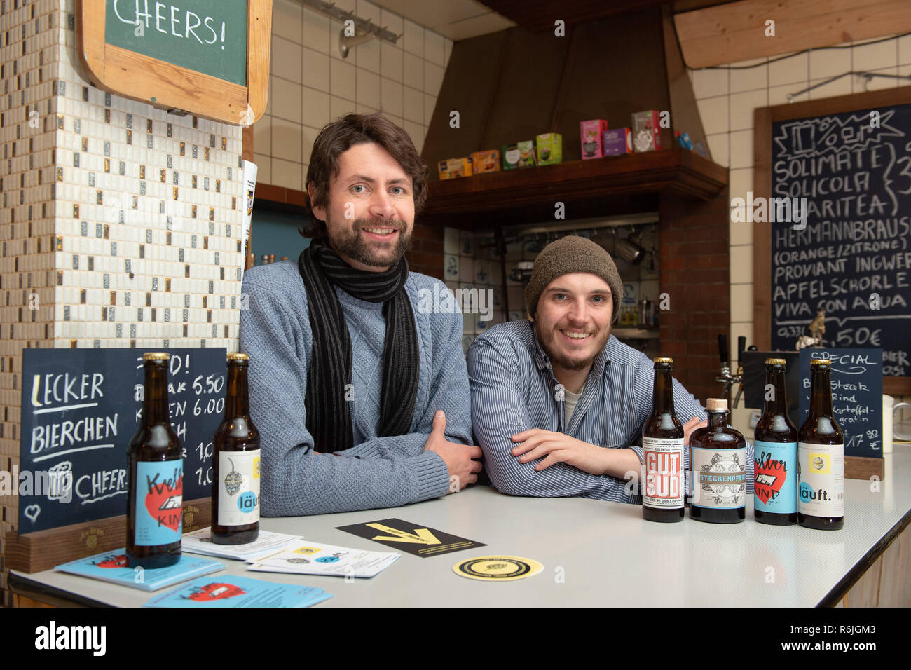 """Kassel, Germany. 22nd Nov, 2018. Johannes Alt (l) and Erik Schäfer, owner of the brewery Steckenpferd, stand behind the bar in the barroom. (to dpa """"Successful in the niche - Craft beer brewers assert themselves on the market"""" of 06.12.2018) Credit: Swen Pförtner/dpa/Alamy Live News Stock Photo"""