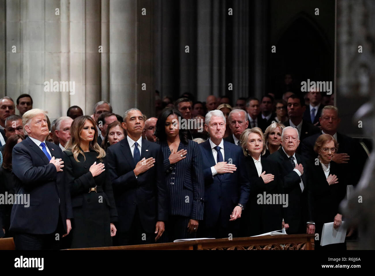 From left, President Donald Trump, first lady Melania Trump, former President Barack Obama, former first lady Michelle Obama, former President Bill Clinton, former Secretary of State Hillary Clinton, and former President Jimmy Carter and former first lady Rosalynn Carter participate in the State Funeral for former President George H.W. Bush, at the National Cathedral, Wednesday, Dec. 5, 2018 in Washington.  Credit: Alex Brandon / Pool via CNP | usage worldwide Stock Photo