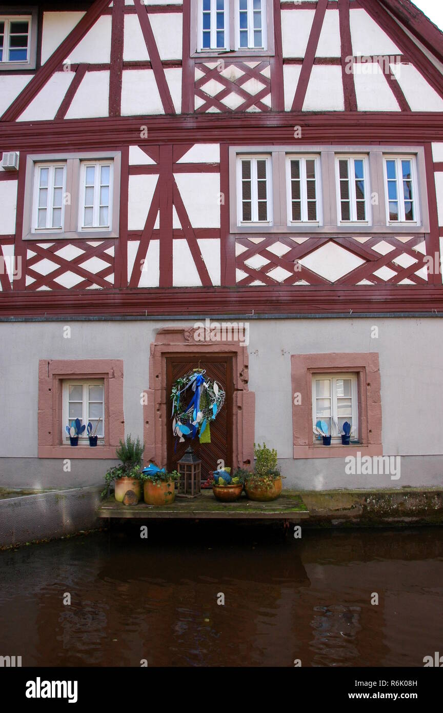 half-timbered house on the queich in annweiler Stock Photo