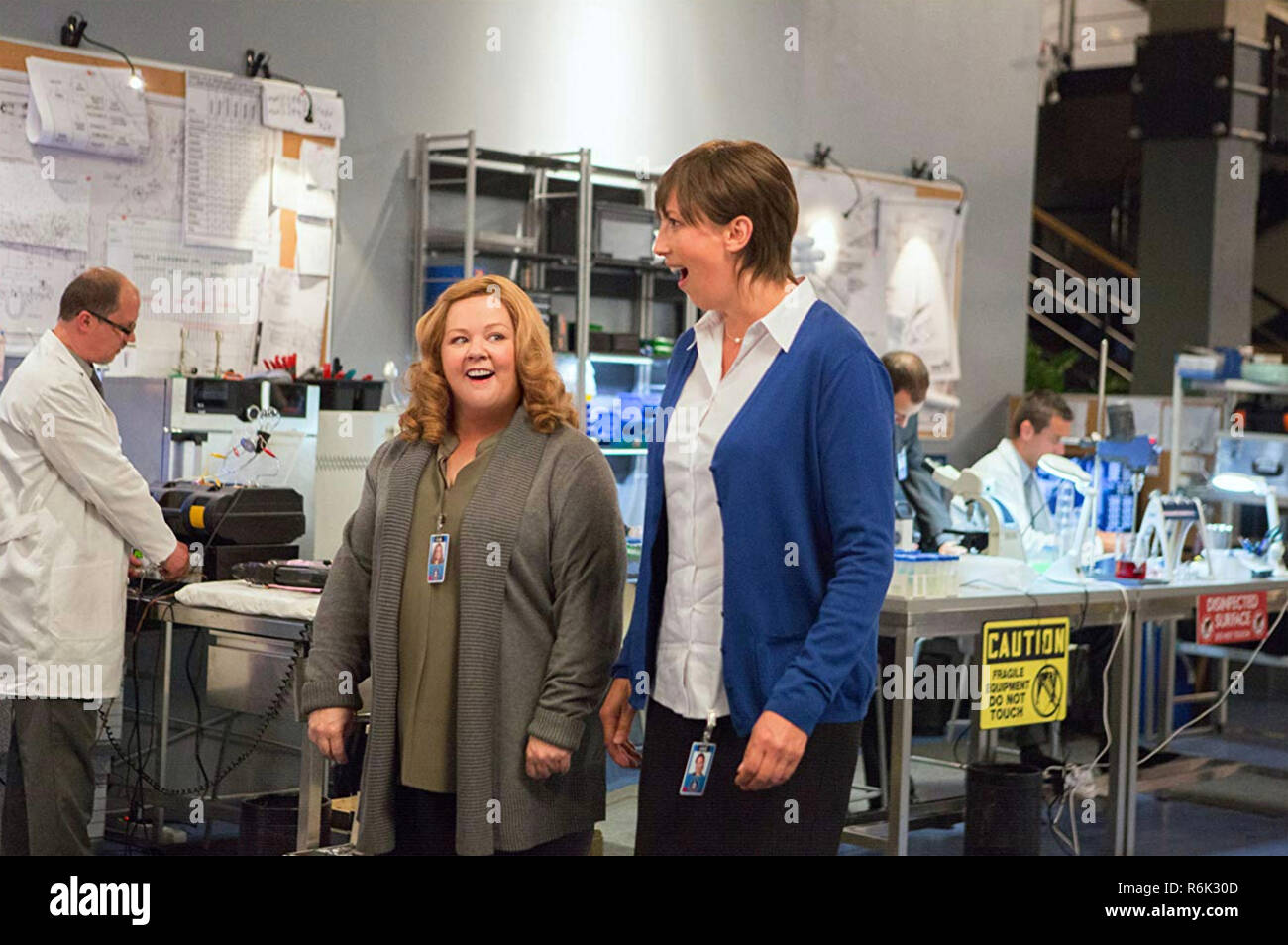 SPY 2015 20th Century Fox film with Melissa McCarthy at left and Miranda Hart in a CIA laboratory - Stock Image