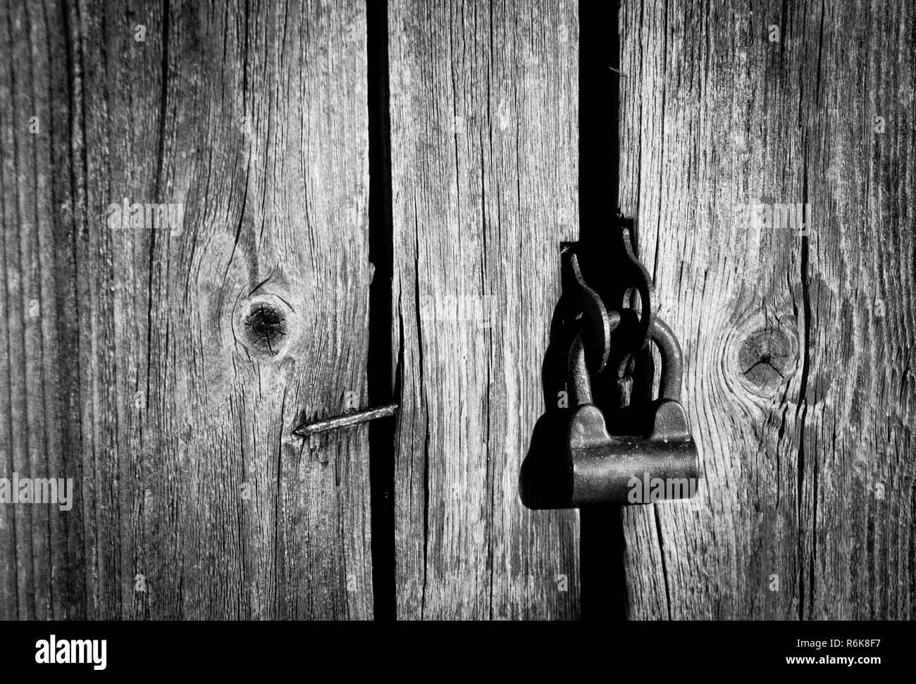 Old lock on the wooden door - Stock Image