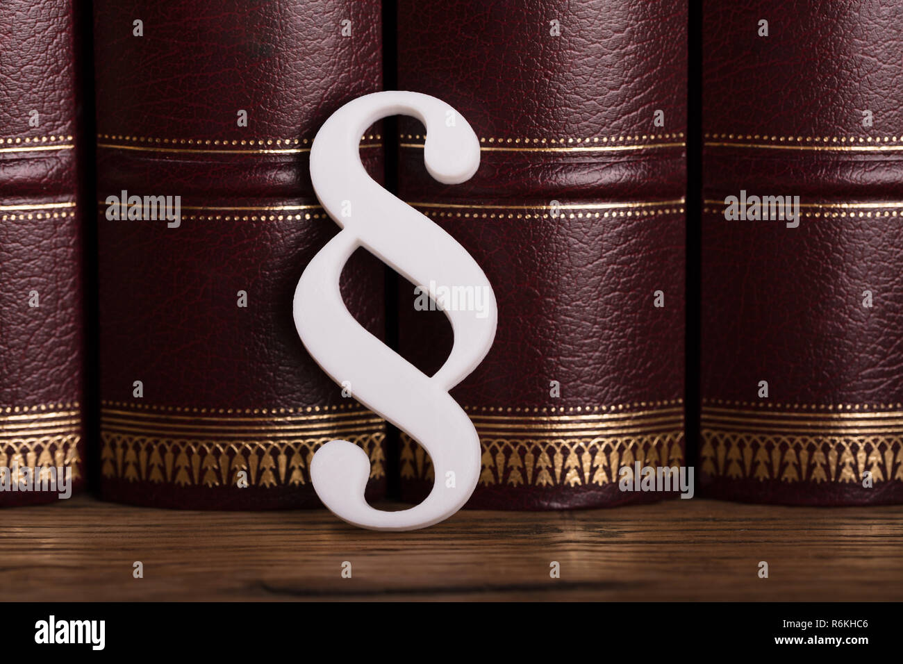 Paragraph Symbol Leaning On Law Books - Stock Image