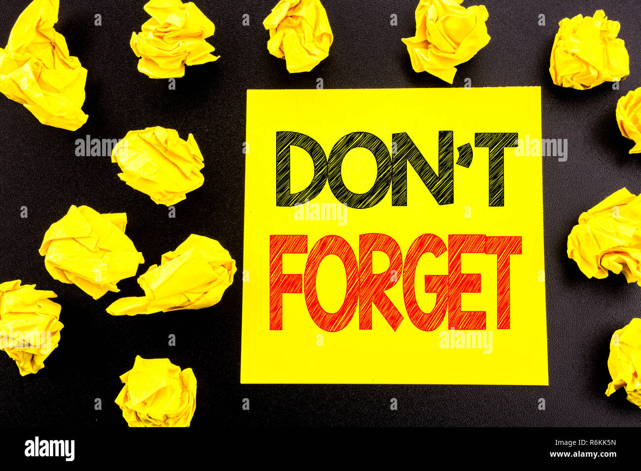 Conceptual hand writing text showing Do Not Forget. Business concept for Don t memory Remider written on sticky note paper. Folded yellow papers on the background - Stock Image