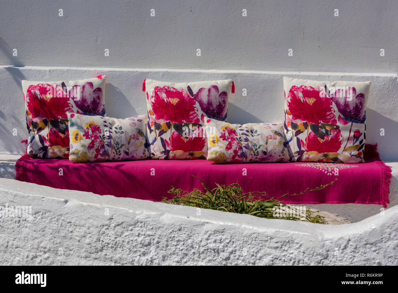 outdoor designer furniture at a greek tavern in kassiopi on the coast of corfu in Greece. - Stock Image