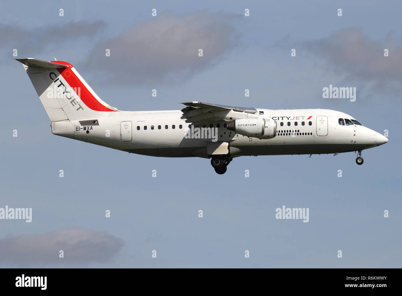 Irish CityJet Avro RJ85 with registration EI-WXA on short final for runway 06 of Amsterdam Airport Schiphol. - Stock Image