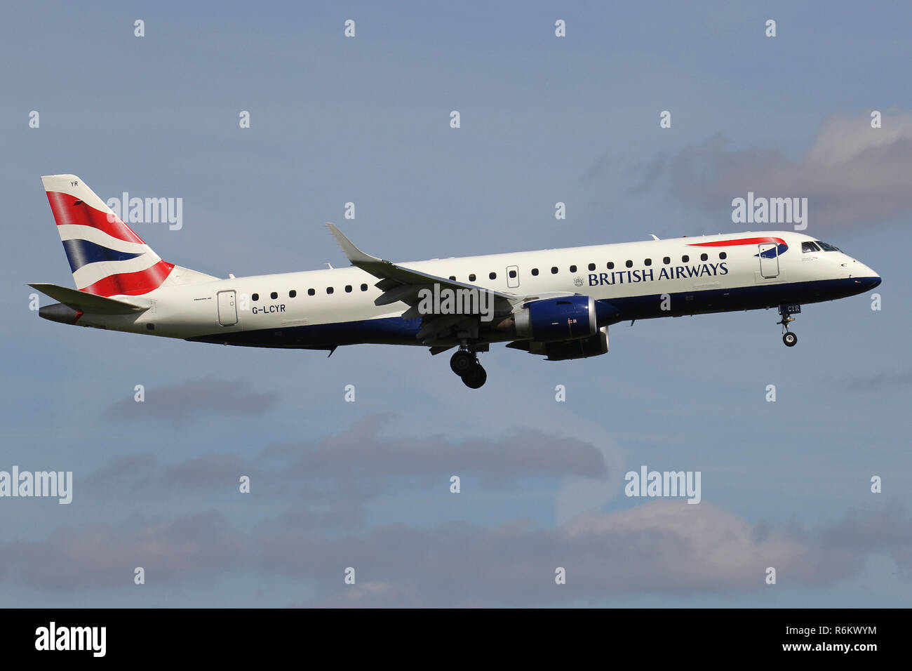 BA CityFlyer Embraer ERJ-190 with registration G-LCYR on short final for runway 06 of Amsterdam Airport Schiphol.Stock Photo