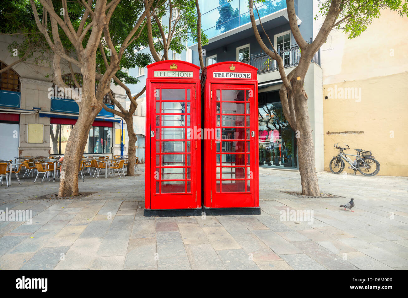 Cityscape with two English red telephone boxes on street at centre of town.  Gibraltar - Stock Image