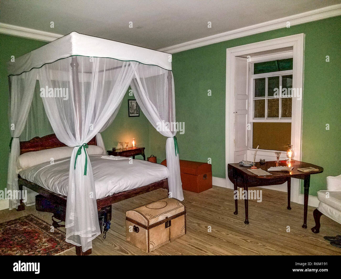 Restored bedroom occupied by George Washington's ailing brother Lawrence, at the house they occupied in Bridgetown, Barbados. - Stock Image