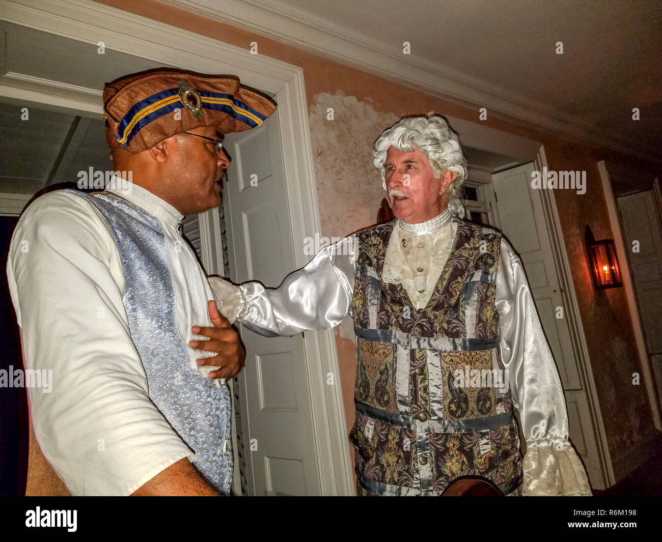 'George Washington' with his friend but also house slave, Pompey during recreation of a dinner of those times for visitors at 'Dinner With George.' - Stock Image