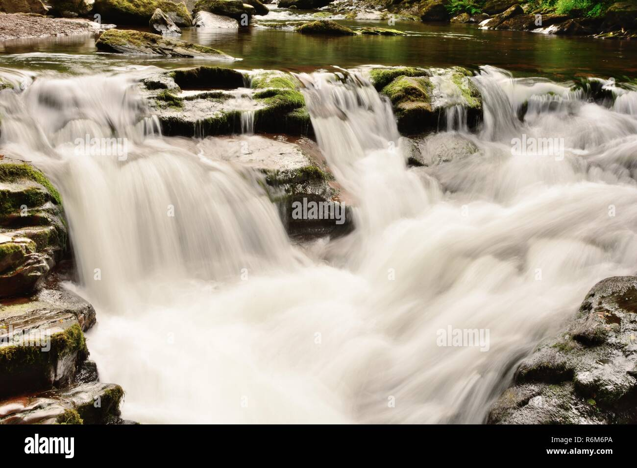 Long exposure of a waterfalll at Watersmeet in Devon - Stock Image