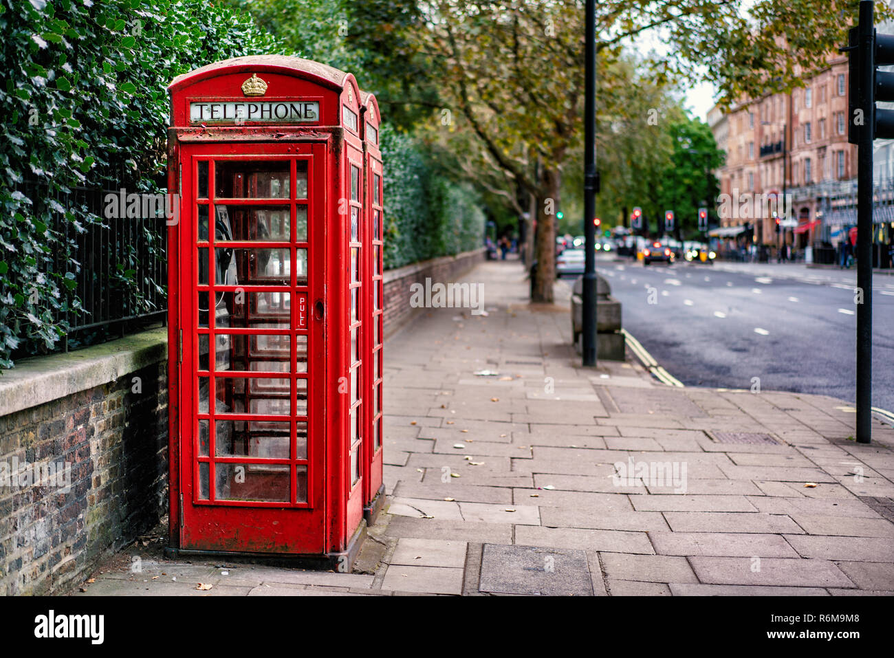 Traditional Red Telephone Box in London city, England - Stock Image