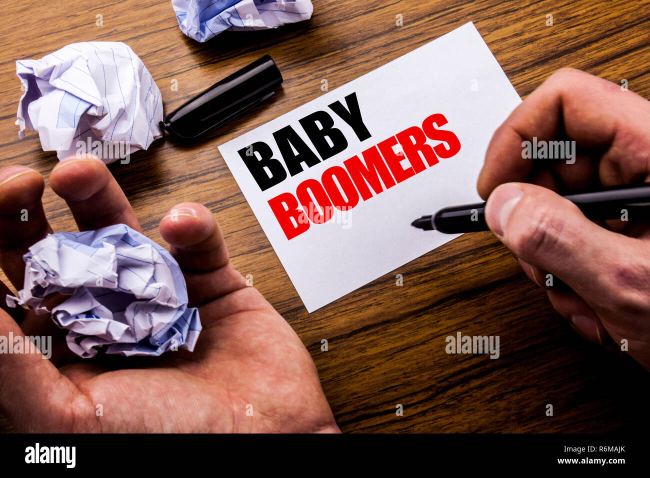 895eb57d89 Handwriting text Baby Boomers. Concept for Demographic Generation written  on notebook note paper on the wooden background with folded paper meaning  thinking ...