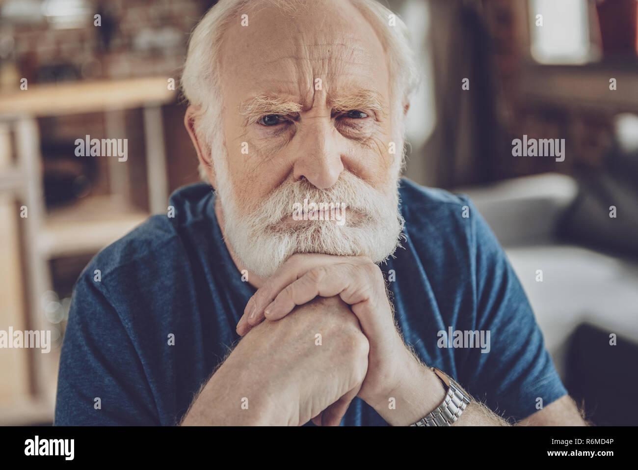 Emotional bearded man posing on camera - Stock Image
