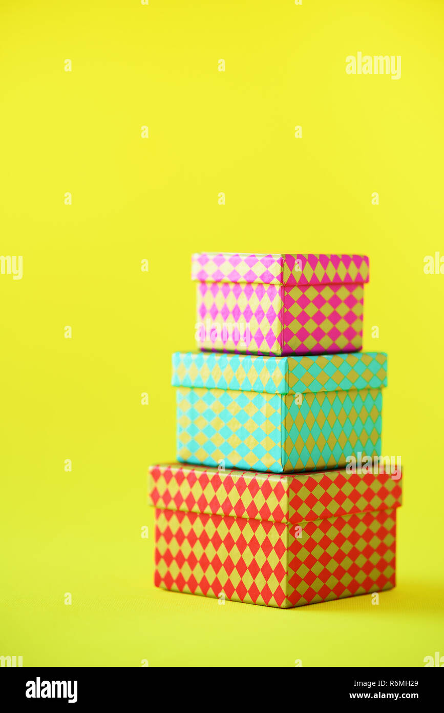 Collection Of Colorful Gift Boxes On Yellow Background Presents For