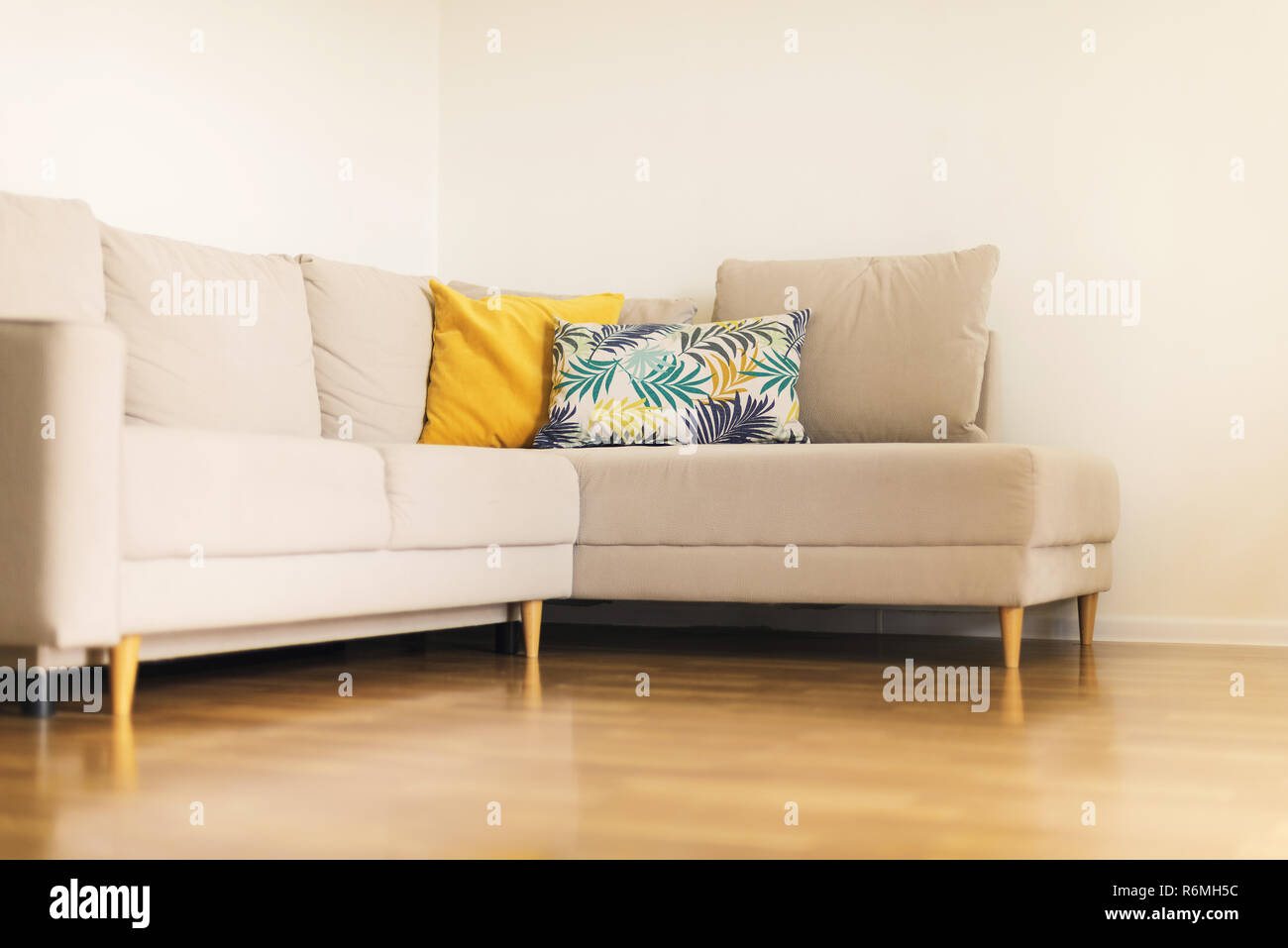 Outstanding Modern Beige Sofa Yellow And Blue Pillows With Tropical Bralicious Painted Fabric Chair Ideas Braliciousco