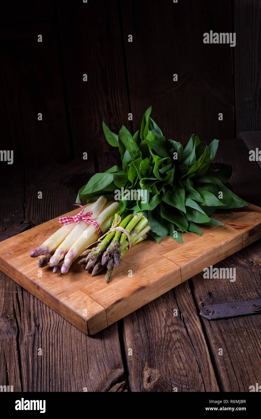 bear's garlic with white and green asparagus Stock Photo