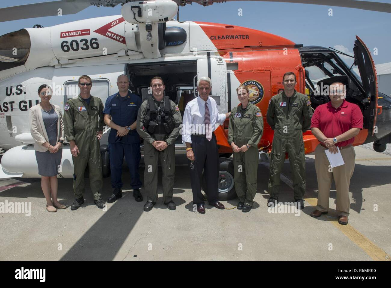 Congressman Charlie Crist, U.S. Representative for Florida's 13th District, center, meets with Air Station Clearwater crew members for a group photo Tuesday, May 30, 2017, prior to an aerial assessment of beach erosion along Pinellas County, Florida's coast. Coast Guard Air Station Clearwater MH-60 Jayhawk helicopter crew members provided the overflight for the congressman and Army Corps of Engineers personnel. - Stock Image