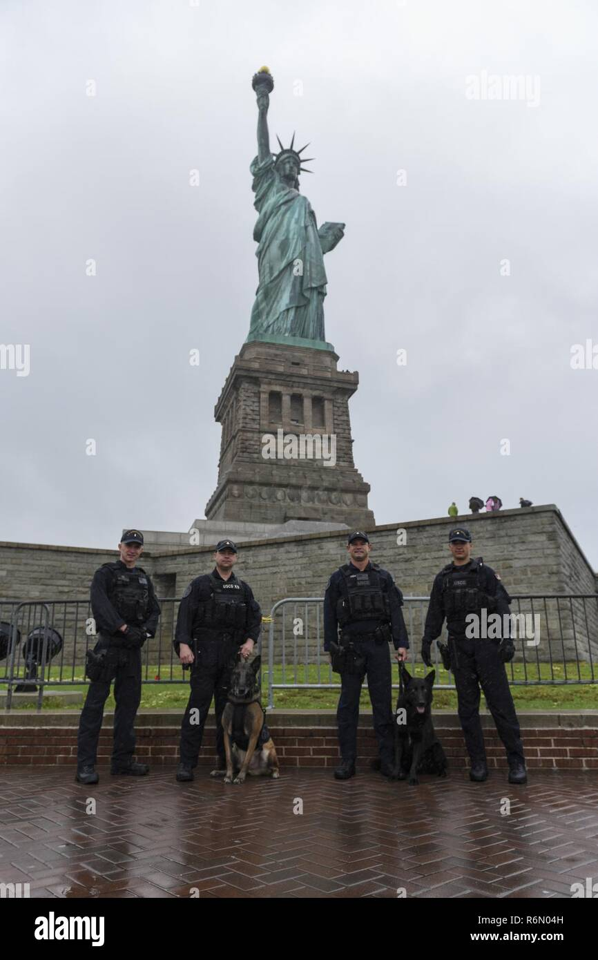 Members of Coast Guard MSST New York and MSST Houston pose while conducting  security sweeps of Liberty Island with canines 5a0d8d211b6