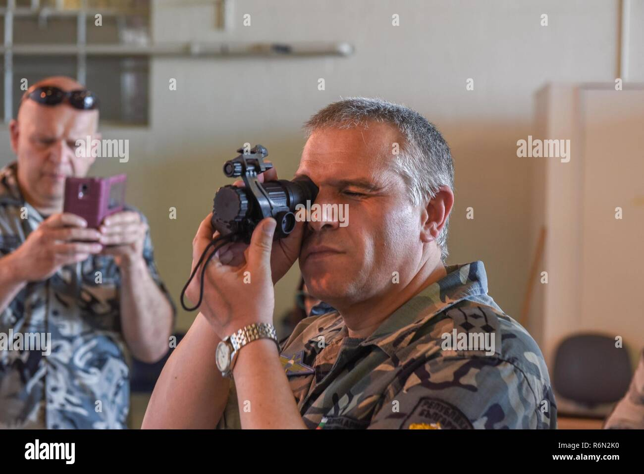 Col. Nikolay Lyaskovski, head of Force Protection in the Branch of Training Department for the Bulgarian Air Force, examines a night vision lens on May 31, 2017 at Berry Field Air National Guard Base, Nashville, Tenn. Tennessee partners with Bulgaria under the State Partnership Program, which is designed to train allied forces, build international relationships, and enhance regional security. Stock Photo
