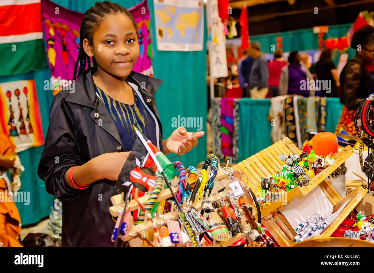 A Kenyan girl sells souvenirs at the 34th annual Mobile International Festival, Nov. 17, 2018, in Mobile, Alabama. Stock Photo
