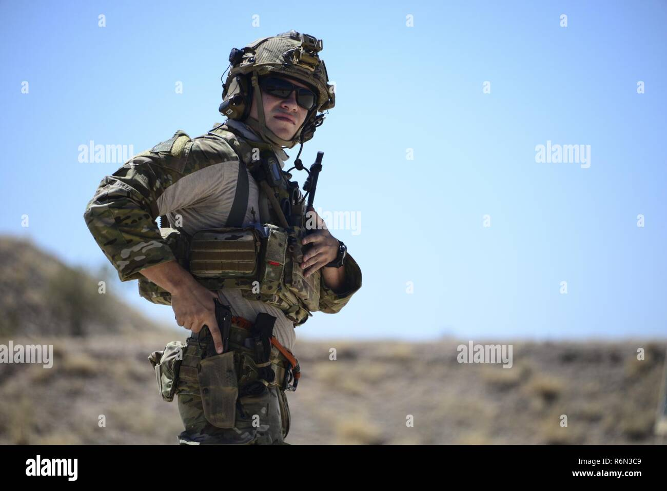 A U.S. Air Force pararescueman holsters his weapon during the Guardian Angel Mission Qualification Training course at Davis-Monthan Air Force Base, Ariz., May 17, 2017. The MQT is a 90 day GA Formal traning course that takes pararescuemen who have completed Air Education and Training Command schooling and helps them achieve their 5-level qualification. - Stock Image