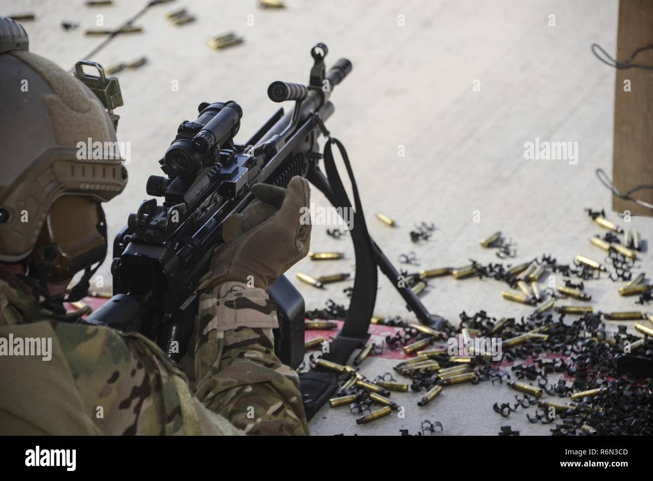 A U.S. Air Force pararescueman fires an M249 automatic rifle during the Guardian Angel Mission Qualification Training course at Davis-Monthan Air Force Base, Ariz., May 18, 2017. The MQT is a 90 day course that takes pararescuemen who have completed Air Education and Training Command schooling and helps them achieve their 5-level qualification. - Stock Image
