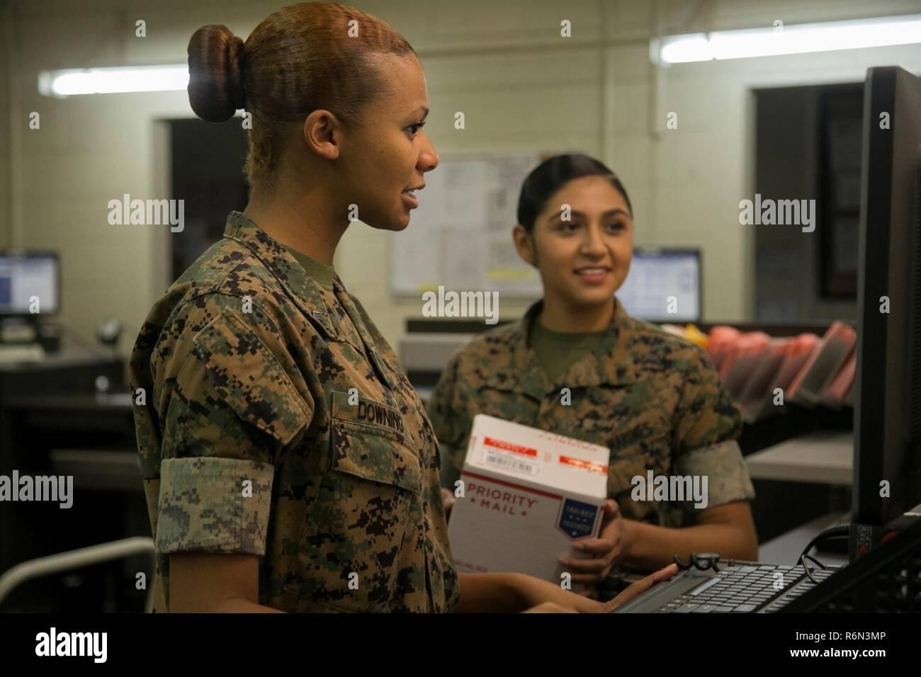 CAMP KINSER, OKINAWA, Japan – Staff Sgt  Tina Downing, left, teaches
